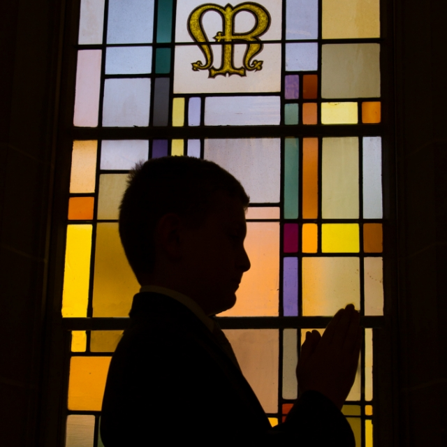 First Communion portrait with stained glass window