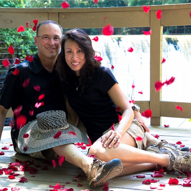 Engagement couple in rose petals