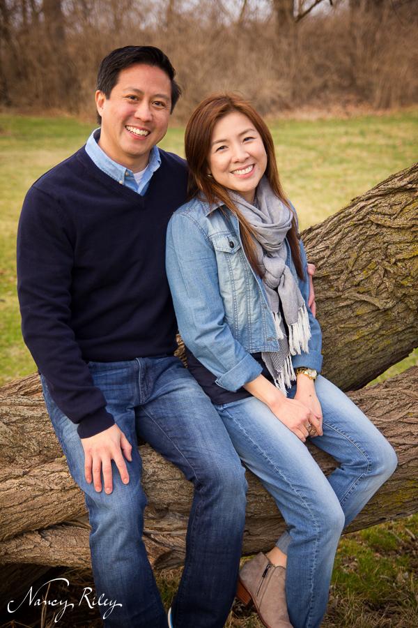 Couple sitting on tree