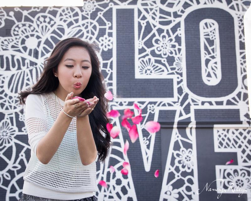 Cincinnati senior fashion shoot blowing rose petals love mural