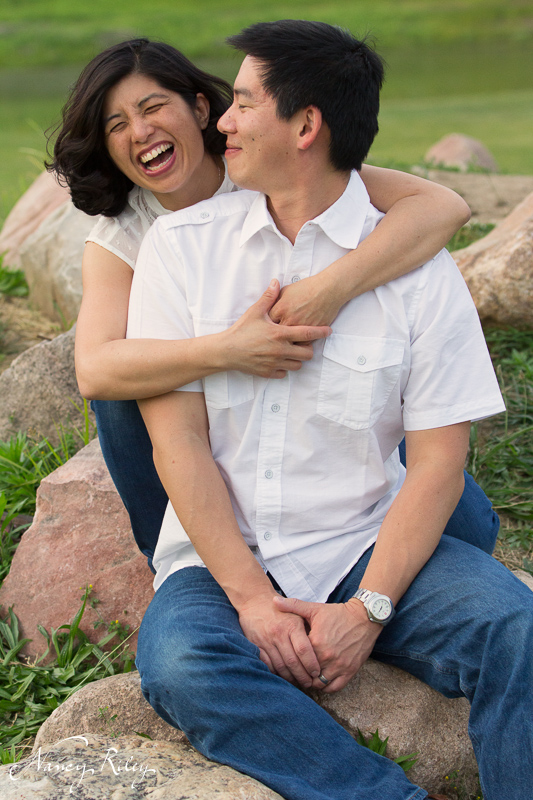 couple with woman laughing