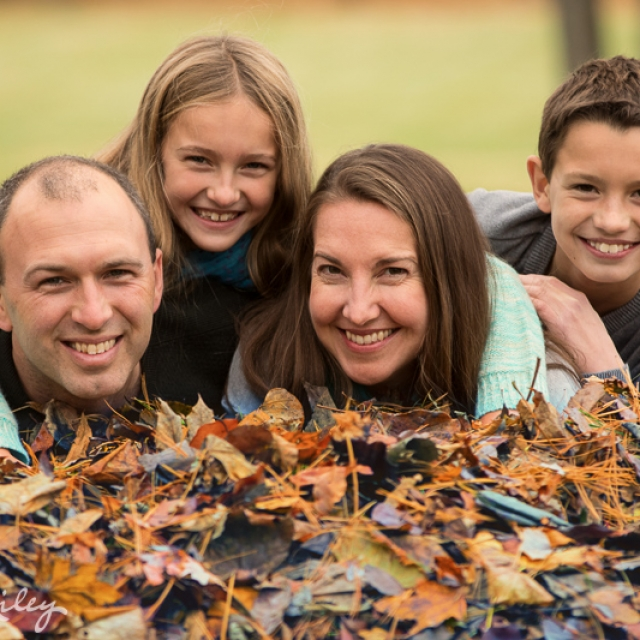 Family in leaves