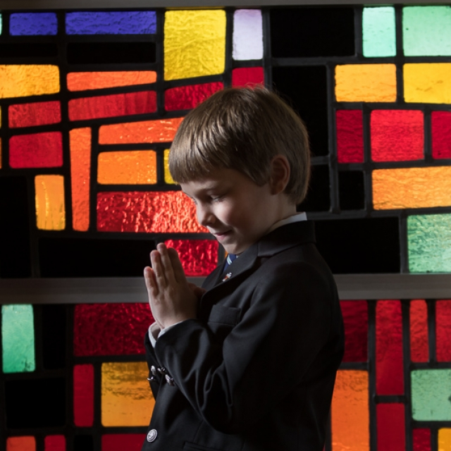 First Communion Andrew praying in window