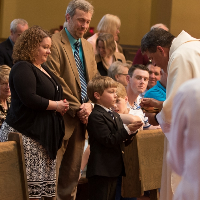 First Communion Andrew with parents