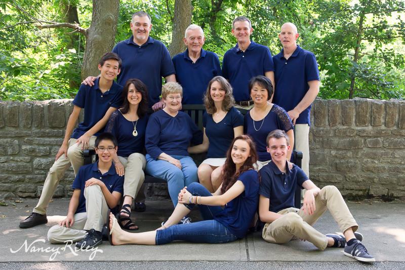 Extended family on stone bridge